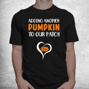 adding another pumpkin to our patch halloween pregnancy shirt 1