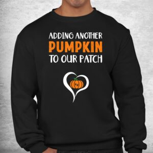 adding another pumpkin to our patch halloween pregnancy shirt 2