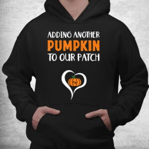 adding another pumpkin to our patch halloween pregnancy shirt 3
